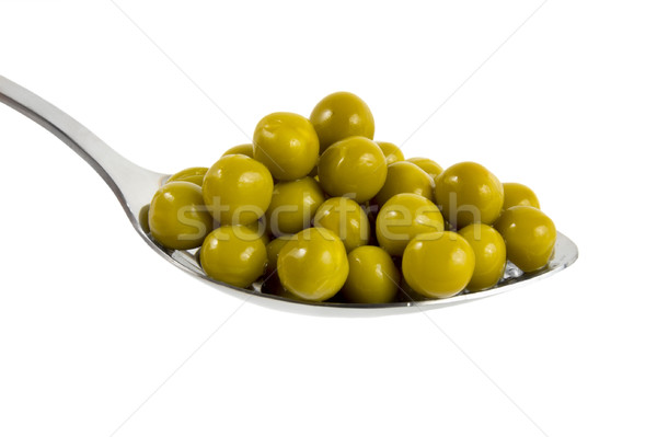 Canned green peas in a spoon Stock photo © Givaga