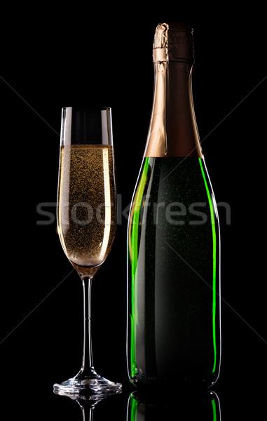 Champagne on black Stock photo © Givaga