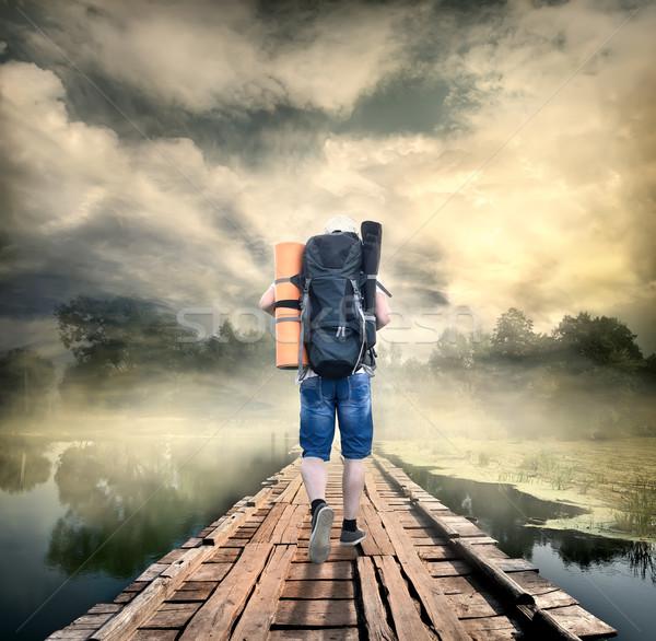 Tourist on the wooden bridge Stock photo © Givaga
