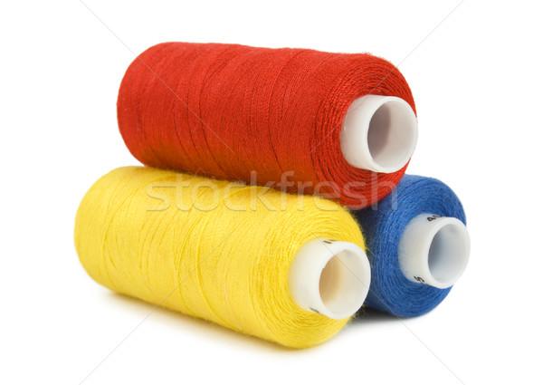 Fio isolado três vermelho de costura têxtil Foto stock © Givaga