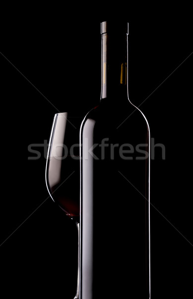 Glass and bottle of red wine Stock photo © Givaga