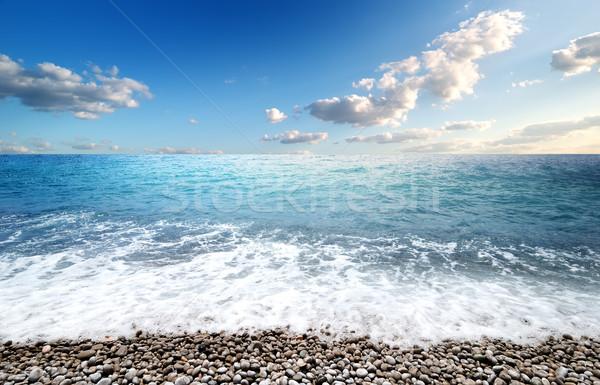 Mare ciottolo spiaggia acqua natura sfondo Foto d'archivio © Givaga