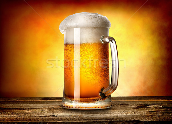 Beer on yellow background Stock photo © Givaga