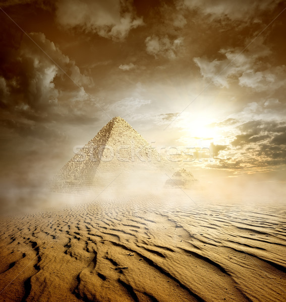 Storm clouds and pyramids Stock photo © Givaga