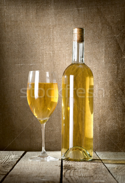Dessert wine and glass on the canvas Stock photo © Givaga