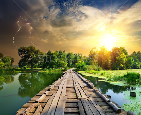 Lightning over the wooden bridge Stock photo © Givaga