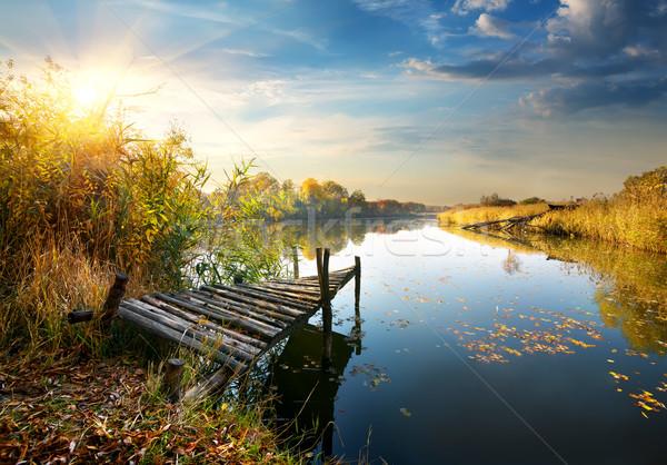 Old pier on autumn river Stock photo © Givaga