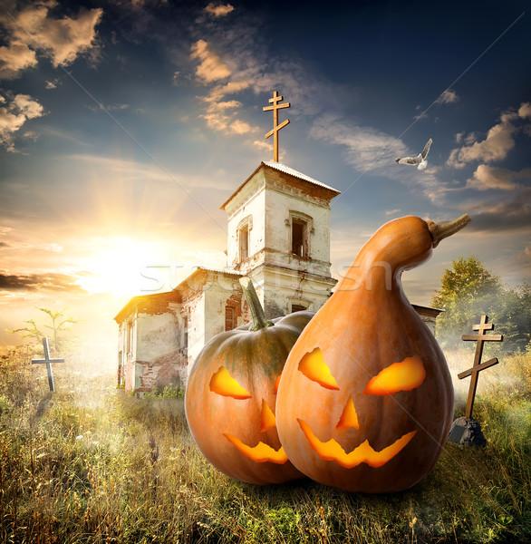 Pumpkins on churchyard Stock photo © Givaga
