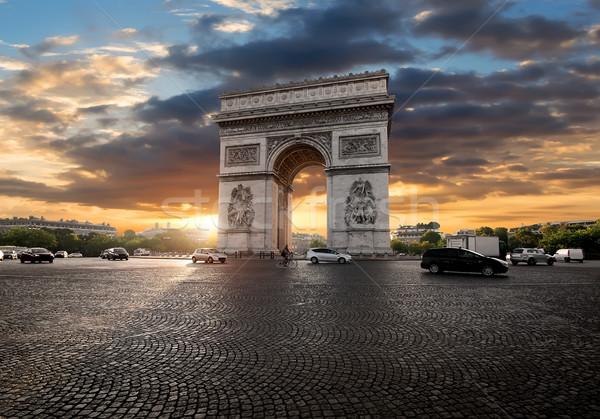 Arch nubi sunrise Parigi Francia auto Foto d'archivio © Givaga