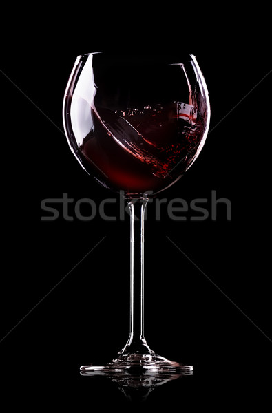 Wave of wine in wineglass Stock photo © Givaga