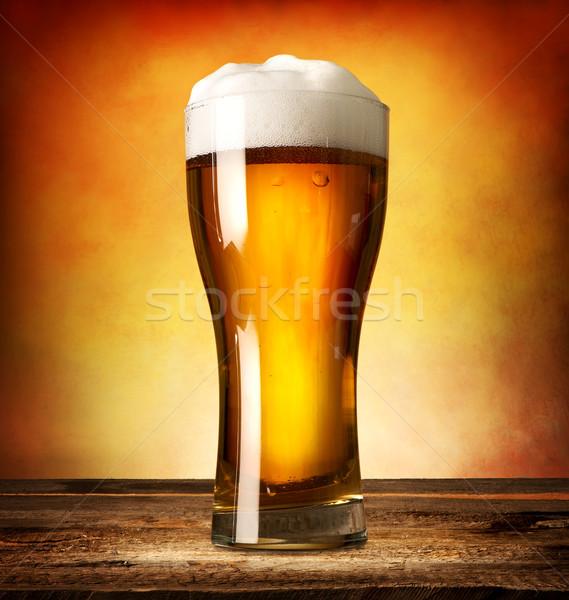 Cam alman birası ahşap masa ışık arka plan kabarcıklar Stok fotoğraf © Givaga