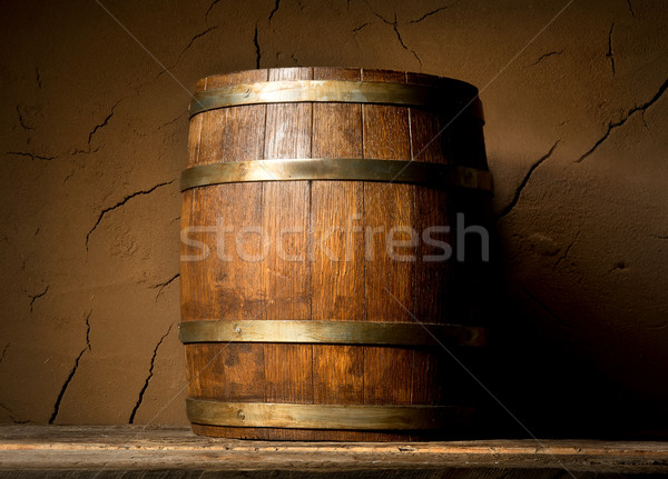 Cask and clay wall Stock photo © Givaga
