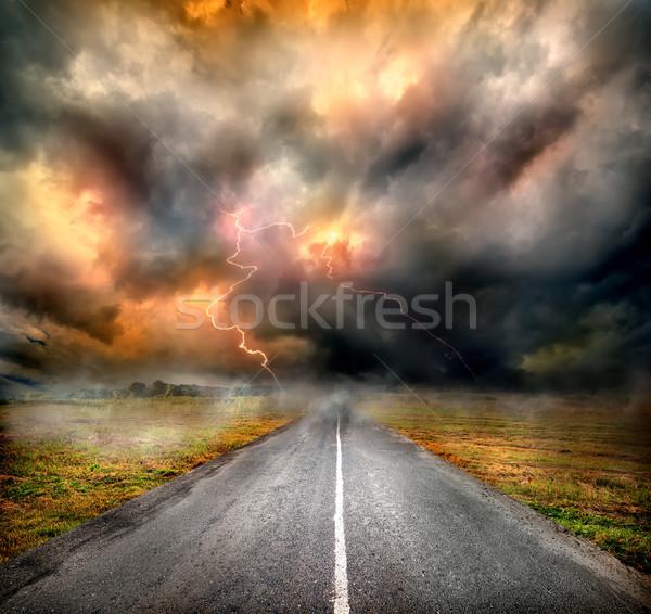 Fırtına bulutları yıldırım karayolu alan çim manzara Stok fotoğraf © Givaga