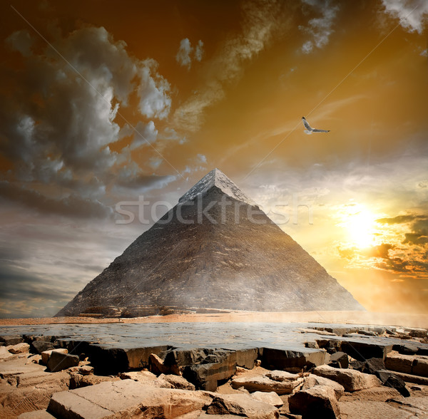 Pyramid under clouds Stock photo © Givaga