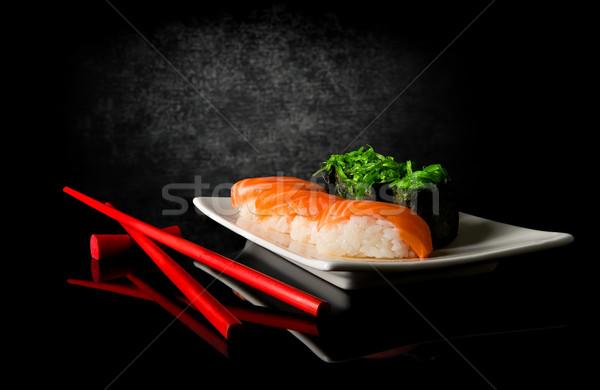 суши палочки для еды черный фон таблице зеленый Сток-фото © Givaga