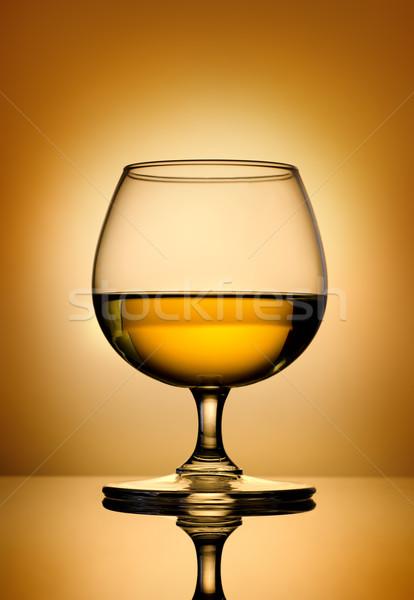 Brandy on a gold background Stock photo © Givaga