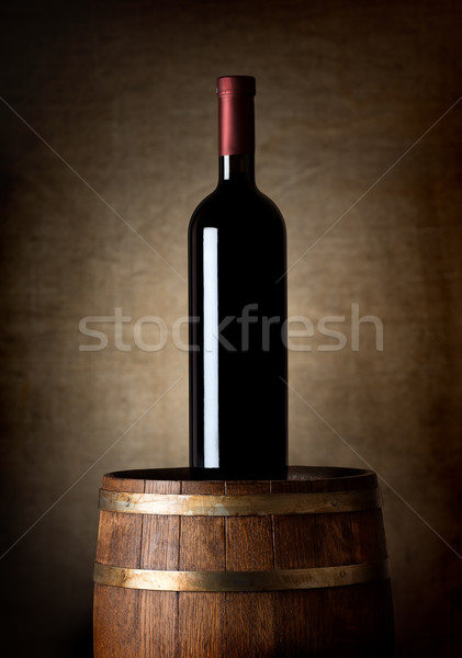 Bottle of wine on a barrel Stock photo © Givaga