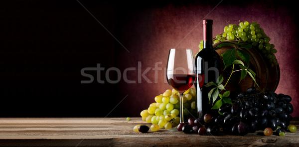 Vine of grape with wine Stock photo © Givaga