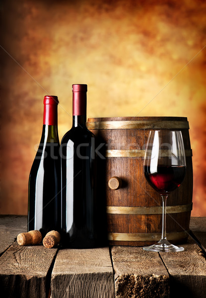 Stock photo: Bottles and cask of wine