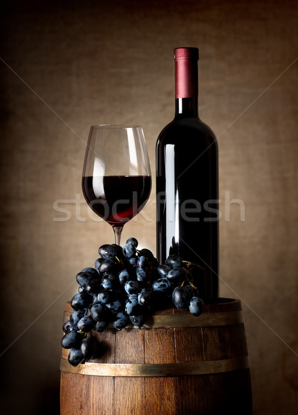Red wine with barrel and grapes Stock photo © Givaga