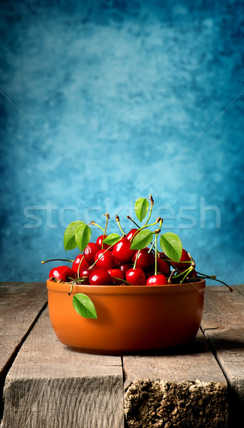 Cherries in brown plate Stock photo © Givaga