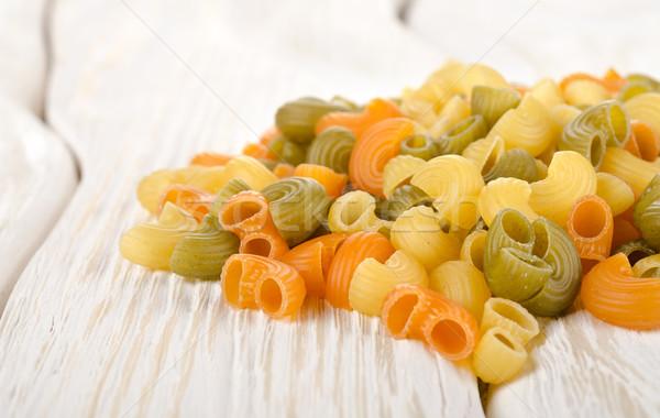 Kleurrijk pasta tabel witte houten tafel voedsel Stockfoto © Givaga