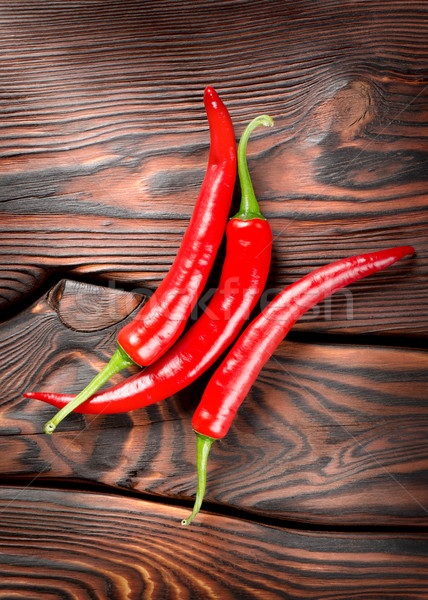 Chili on a wooden background Stock photo © Givaga