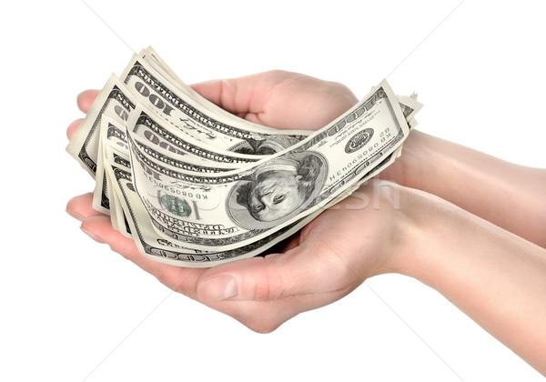 Hand holds hundreds of dollars Stock photo © Givaga