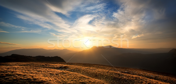 Sunset over the mountain Stock photo © Givaga