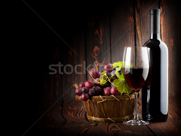 Wine on the dark wooden background Stock photo © Givaga
