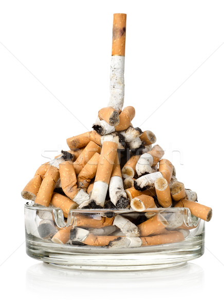 Cigarettes in a glass ashtray Stock photo © Givaga