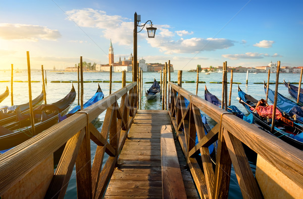 Gondolas and pier Stock photo © Givaga