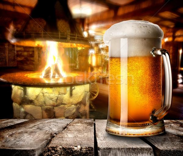 Köpüklü bira kupa ahşap masa bar yangın Stok fotoğraf © Givaga