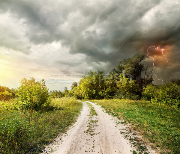 Country road and thunderstorm Stock photo © Givaga