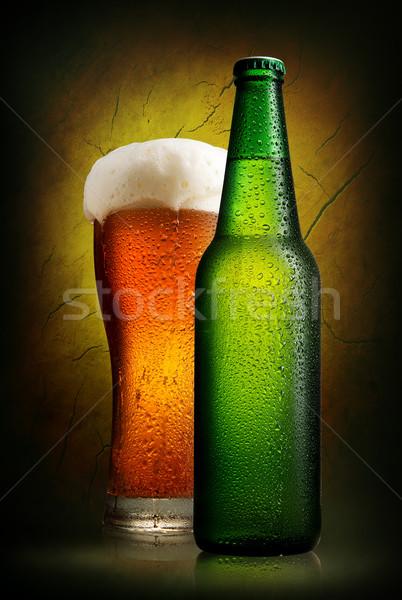 Cerveja argila parede vidro garrafa velho Foto stock © Givaga