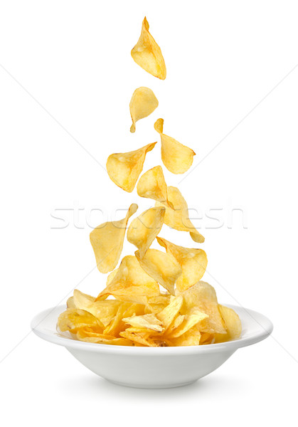 Potato chips falling in the plate Stock photo © Givaga