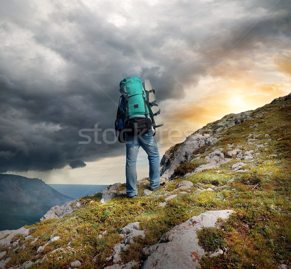 Backpacker bergen donder wolken man abstract Stockfoto © Givaga