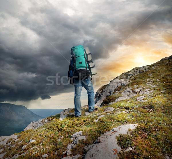 Hátizsákos turista hegyek vihar felhők férfi absztrakt Stock fotó © Givaga