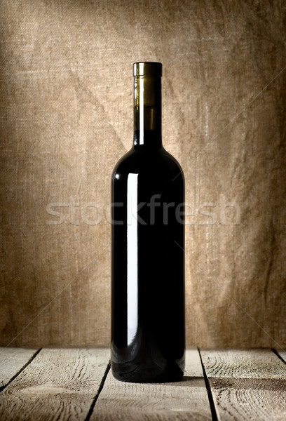 Black bottle of red wine Stock photo © Givaga