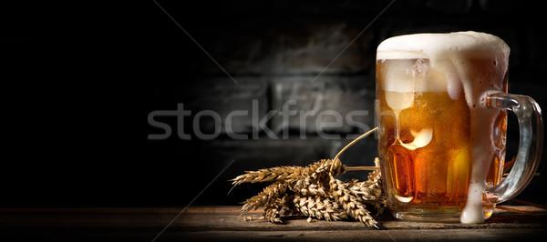 Beer in mug on table Stock photo © Givaga