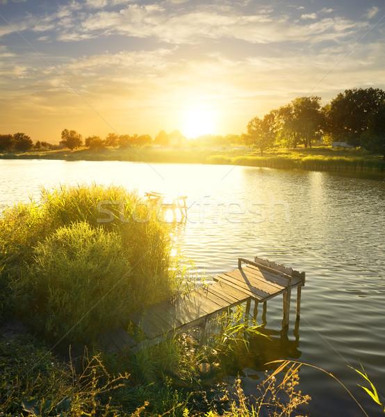 Połowów molo rzeki Świt niebo Zdjęcia stock © Givaga