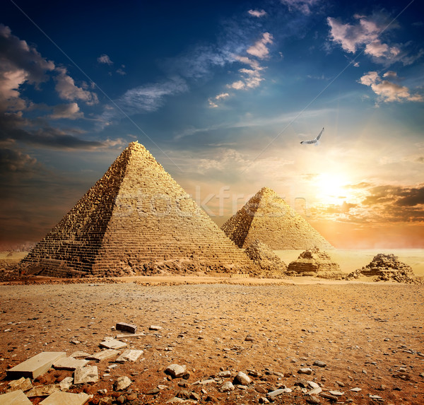 Stock photo: Sunset over pyramids