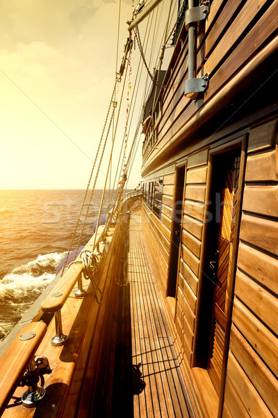 Wooden sailboat in sea Stock photo © Givaga