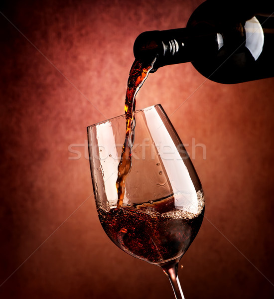 Wine on brown background Stock photo © Givaga