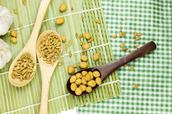 Sunflower seeds and nuts coated on spoon. Stock photo © Gloszilla