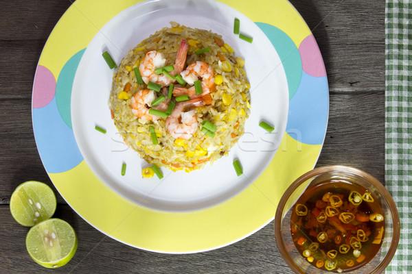Frito arroz camarão mesa de madeira água comida Foto stock © Gloszilla