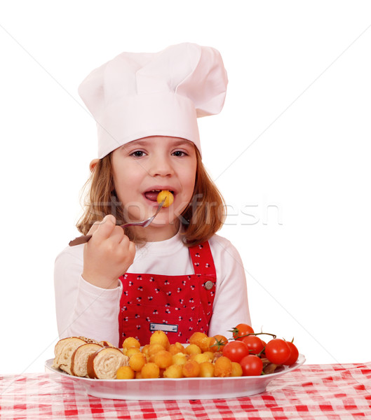 hungry little girl cook eat gourmet food Stock photo © goce
