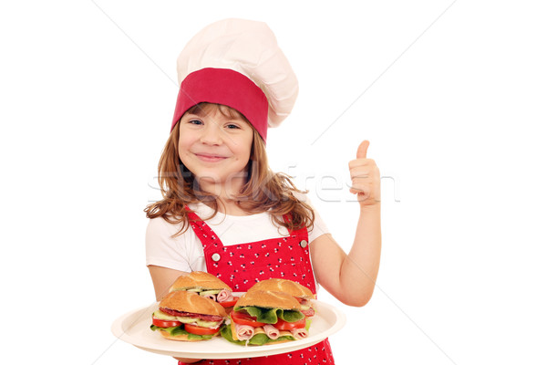 happy little girl cook with sandwiches and thumb up Stock photo © goce