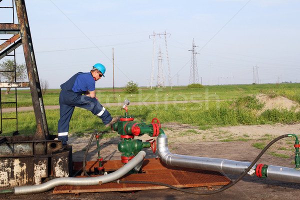 oilfield with worker and pipeline Stock photo © goce