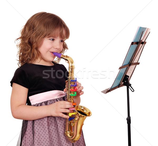 девочку саксофон музыку счастливым ребенка красоту Сток-фото © goce